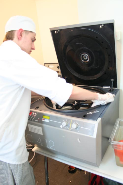 Intern sterilizing Jouan centrifuge with concentrated bleach solution