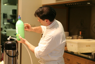 Carbonating the clarified apples, rum and sake.